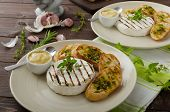 stock photo of baguette  - Grilled camembert with Dijon mustard and herbs baguettes