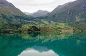 picture of fjord  - Reflection in Norway fjord at fall time - JPG