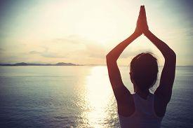 stock photo of japanese woman  - healthy yoga woman meditation at sunrise seaside - JPG