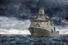 picture of heavy  - The military ship on sea against heavy clouds - JPG