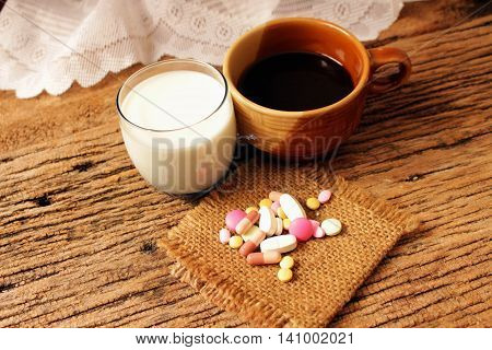healthy care conceptmedecine milk and coffee unable drink with medecine.