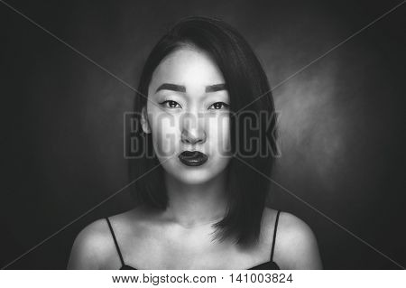 Portrait of asian woman on black background
