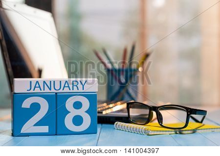 January 28th. Day 28 of month, calendar on blogger workplace background. Winter at work concept. Empty space for text.