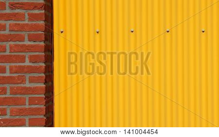 Corrugated steel sheet and brick wall background