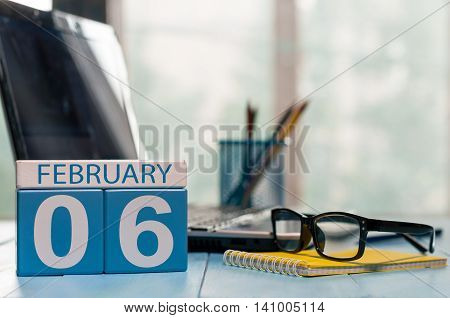 February 6th. Day 6 of month, calendar on accauntant workplace background. Winter time. Empty space for text.