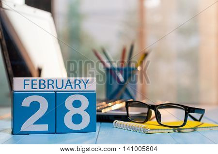 February 28th. Day 28 of month, calendar on blogger workplace background. Winter at work concept. Empty space for text.