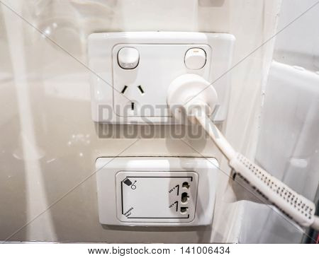 Plug socket for hair dryer and shaver in the bathroom