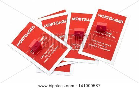 SWINDON UK - August 2 2016: English Edition of Monopoly showing mortgage cards on a white background