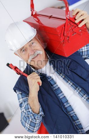 portrait of worker wearing jacket and helmet