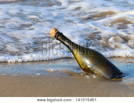 Bottle On The Beach With A Message