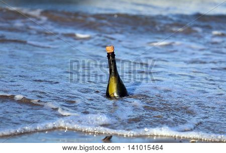 Bottle On The Beach With A Secret Message
