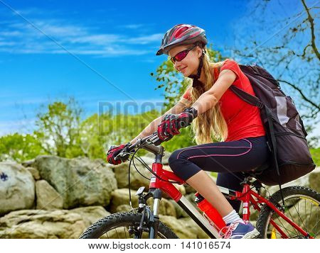 Girl rides bicycle into mountains. Girl on bicycle in mountaineering . Mountaineering is good for health.