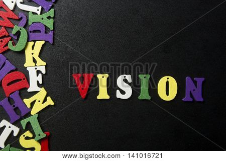 word vision on colorful wooden abc letter.