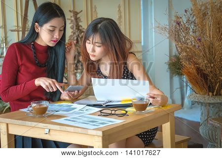 homework, Young businessgirl discussing data at meeting