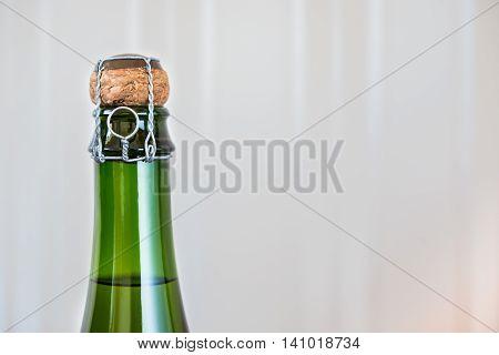 bottle of unopened sparkling wine close up