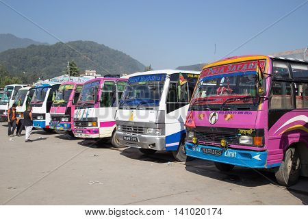 Kathmandu, Nepal - October 22, 2014: Colorful buses standing on the parking lot of a bus station