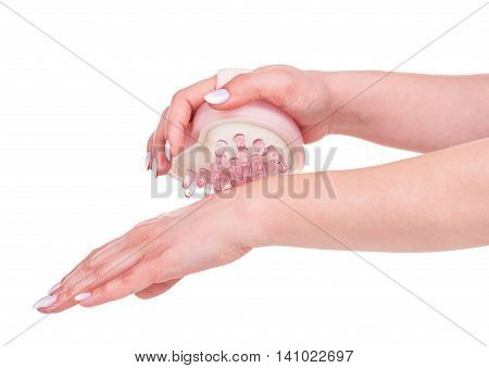 Handheld massager in a form of heart in the female hands isolated over white background