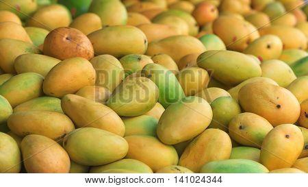 Traditional asian market stall full of fresh mangoes