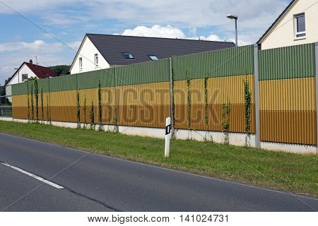 Closeup of a noise barrier wall, background