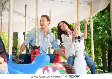 Couple having fun on a carousel
