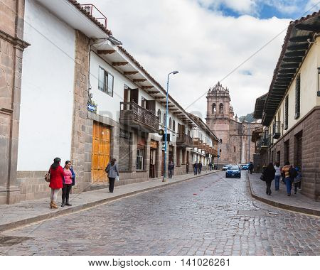Side View Of The Cusco Cathedral With People Walking