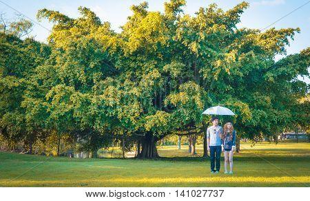 Couple Standing Umbrella White Page Verdant Trees