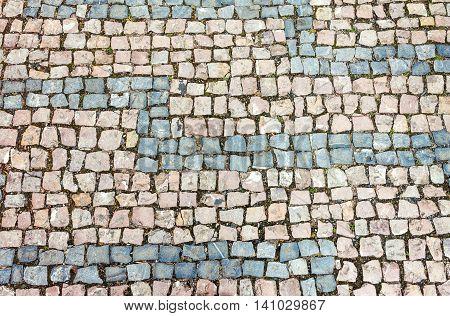 Horizontally oriented cobblestone background. Natural stone texture
