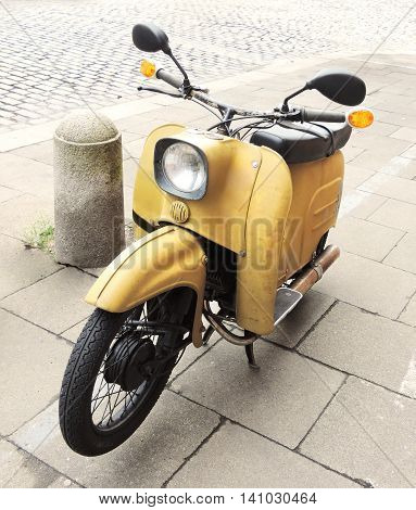Parked motorcycle, antique mofa or retro moped.
