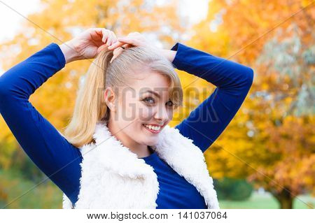 Young Woman Spend Time In Autumnal Park.