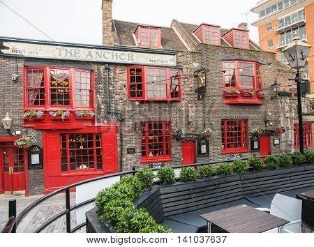 London, England - July 16, 2013; Historic pub The Anchor dates back to 1615 is a landmark property on Bankside Southwark London UK.