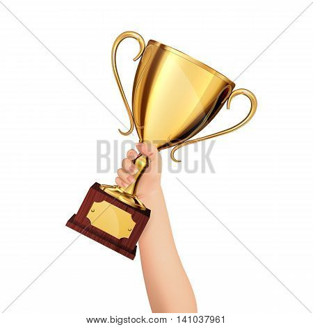 Hand holding a winner trophy cup isolated on a white background