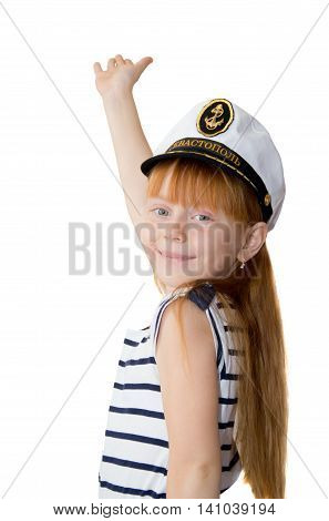 Girl in naval cap with raised hand on white background
