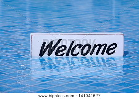 Welcome Sign And Empty Swimming Pool Surface In The Background