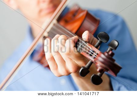 Closeup of a Man Playing a Violin