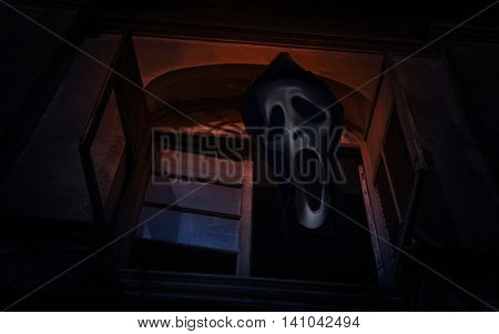 Ghost scream over old ancient window castle Spooky background Halloween concept