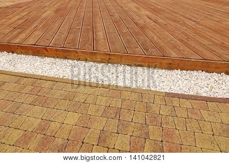Composite Wood Decking, White Marble Gravel And Stone Brick Paving