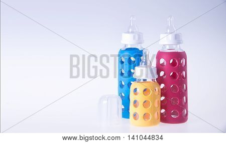 Baby Glass Bottle. Baby Glass Bottle On A Background.