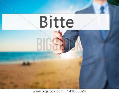Bitte (please In German) - Businessman Hand Holding Sign