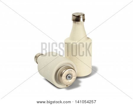 Two retro electrical fuses on white background