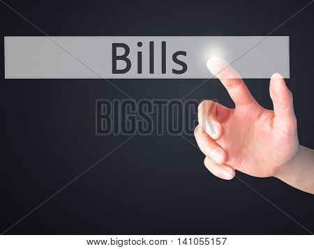 Bills - Hand Pressing A Button On Blurred Background Concept On Visual Screen.