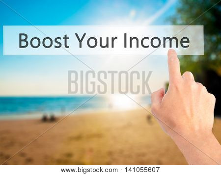 Boost Your Income - Hand Pressing A Button On Blurred Background Concept On Visual Screen.