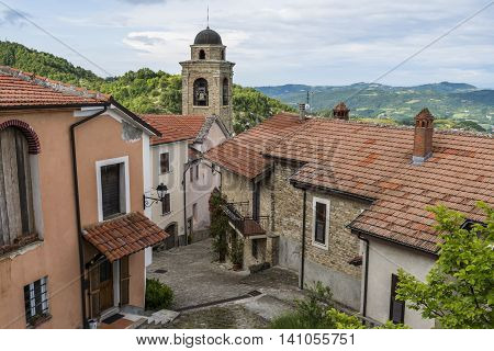 Village of Montechiaro d'Acqui in Piedmont in Italy with small center church houses roofs and balconies.