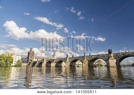 PRAGUE, CZECH REPUBLIC, JULY 5,2016: Wide angle shot of Charles Bridge, a famous historic bridge that crosses the Vltava river in Prague, Czech Republic.