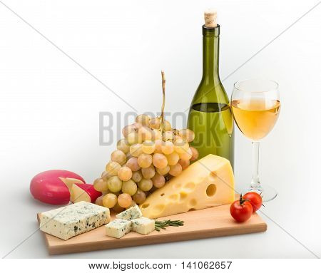 Wine Bottle, Wine Glass, Cheese, Cherry Tomatoes and Grape on the Wooden Platter