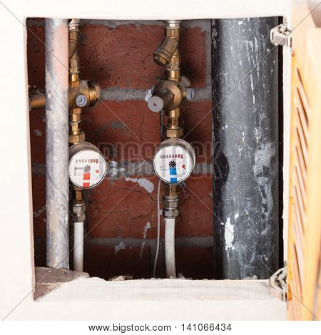 Mechanical Water Meters On Pipes In Niche