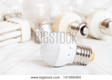 Energy Saving Led Lamp And Several Old Light Bulbs
