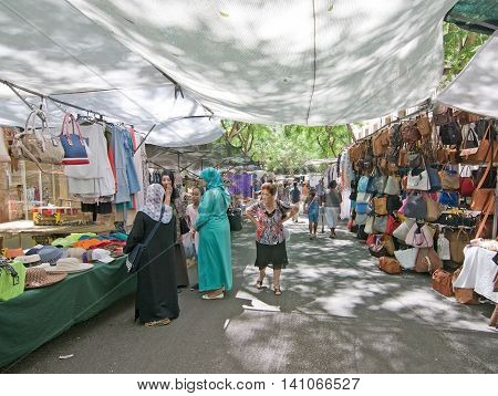 MANACOR BALEARIC ISLANDS SPAIN - JULY 18 2016: Manacor market vendors and shoppers on a hot and sunny summer day on July 18 2016 in Palma de Mallorca Balearic islands Spain.