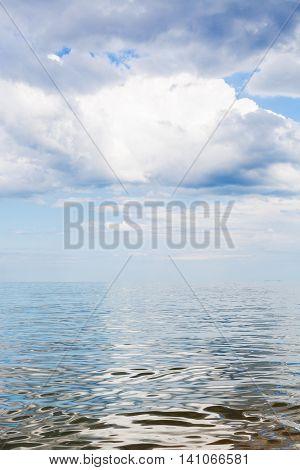 White Clouds Over Calm Water Of Azov Sea