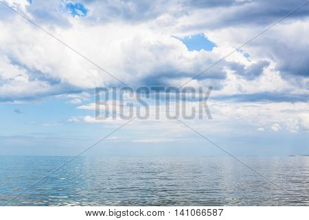 Waterscape With White Clouds And Calm Azov Sea