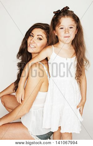 bright picture of hugging mother and daughter happy together, smiling stylish family. girls aloud